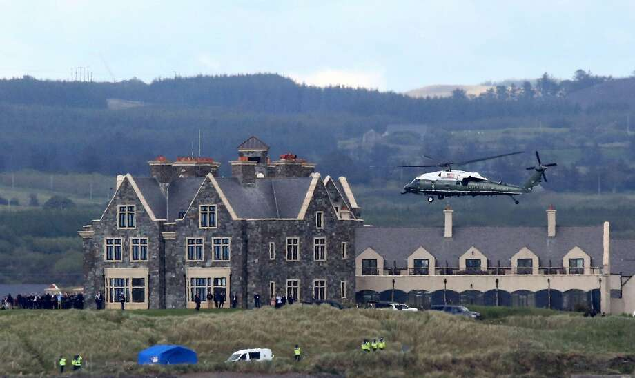 (FILES) In this file photo taken on June 6, 2019, Marine One, carrying US President Donald Trump and First Lady Melania Trump comes in to land at the Trump International Golf resort near the village of Doonbeg in Ireland. - US Vice President Mike Pence, currently visiting Ireland, has chosen to stay at a golf resort owned by Donald Trump, renewing controversy over spending taxpayer money on the president's family businesses. The Trump International Golf Links & Hotel is located in Doonbeg, on the west coast of Ireland, about 185 miles (300 kilometers) from Dublin where Pence's official meetings are being held. (Photo by Paul Faith / AFP)PAUL FAITH/AFP/Getty Images Photo: PAUL FAITH;Paul Faith / AFP / Getty Images