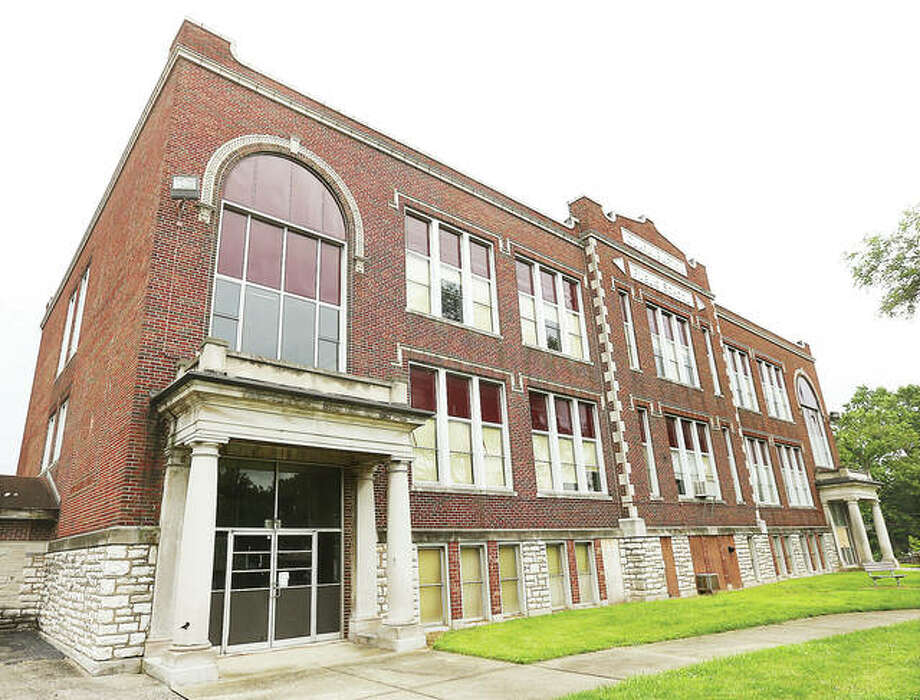 School district officials are accepting bids until Sept. 16 for the old Clara Barton Elementary School at 409 Main St., shown, and the district's former administrative offices at 1854 E. Broadway Ave. Minimum bid for the Barton school is $10; the minimum bid for the administrative building is $50,000.