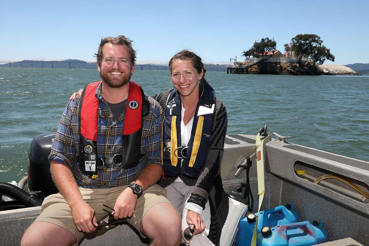 Innkeepers Tyler Waterson (left) and Tiffany Danse (right) give tours of the bed and breakfast at the East Brother Light Station (top right) on a small island just off Point San Pablo Harbor on Tuesday, July 23, 2019 in Richmond, Calif.