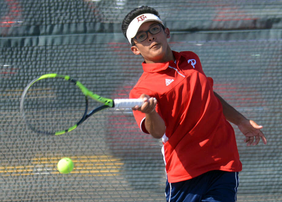 Plainview's Joseph Alcozar awaits his return shot during a second flight doubles match against Dumas in a high school tennis dual on Tuesday on the courts at Plainview High School. Photo: Nathan Giese/Planview Herald