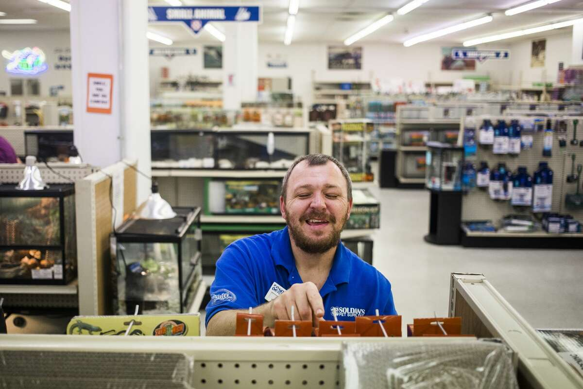 Assistant Manager Paul Hebl stocks merchandise at Soldan's Feeds & Pet Supplies, which was named the 2019 Readers' Choice best place to buy pet supplies. Second place went to Cohoon's Elevator and third place went to Tractor Supply. (Katy Kildee/kkildee@mdn.net)