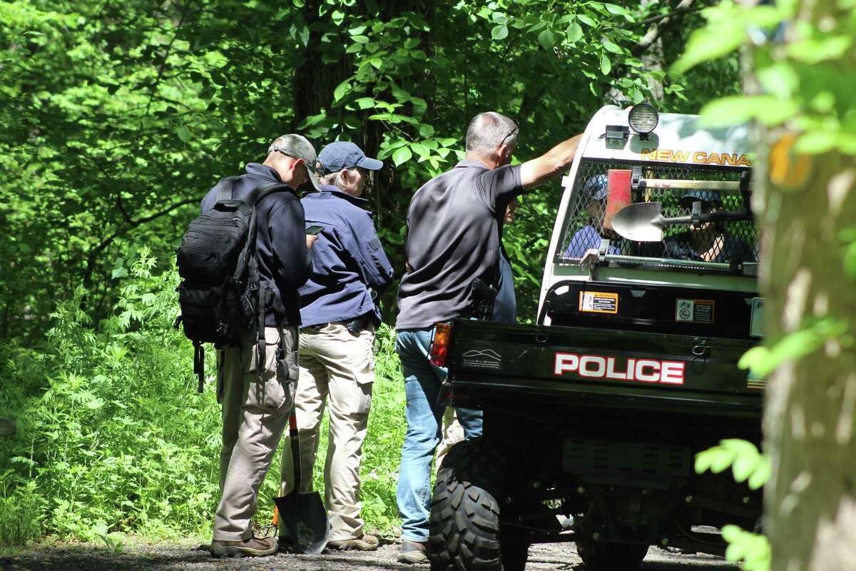 New Canaan Police confer with members of an FBI Evidence Response Team during a search of the woods of Waveny Park near Lapham Road and the Merritt Parkway on Monday, June 3.