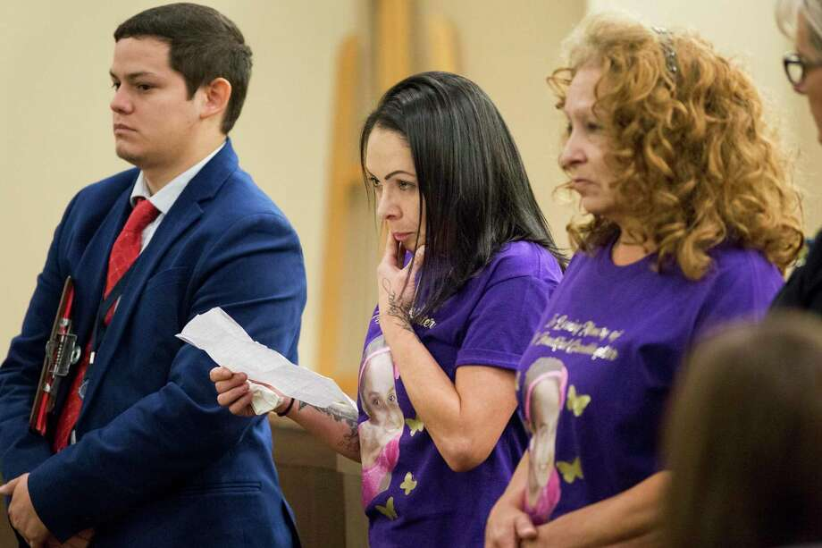 Jackie Vega, center, mother of 10-year-old Delilah Hernandez, who was killed by Cody Gann, reads a letter during the victim impact portion of Gann's sentencing hearing in the 144th state District Court at the Cadena-Reeves Justice Center in San Antonio on Friday, Sept. 6. Gann, who pleaded no contest to killing Delilah in a drive-by shooting, was sentenced to 40 years in prison. Photo: Daniel Carde /Contributor / Daniel Carde