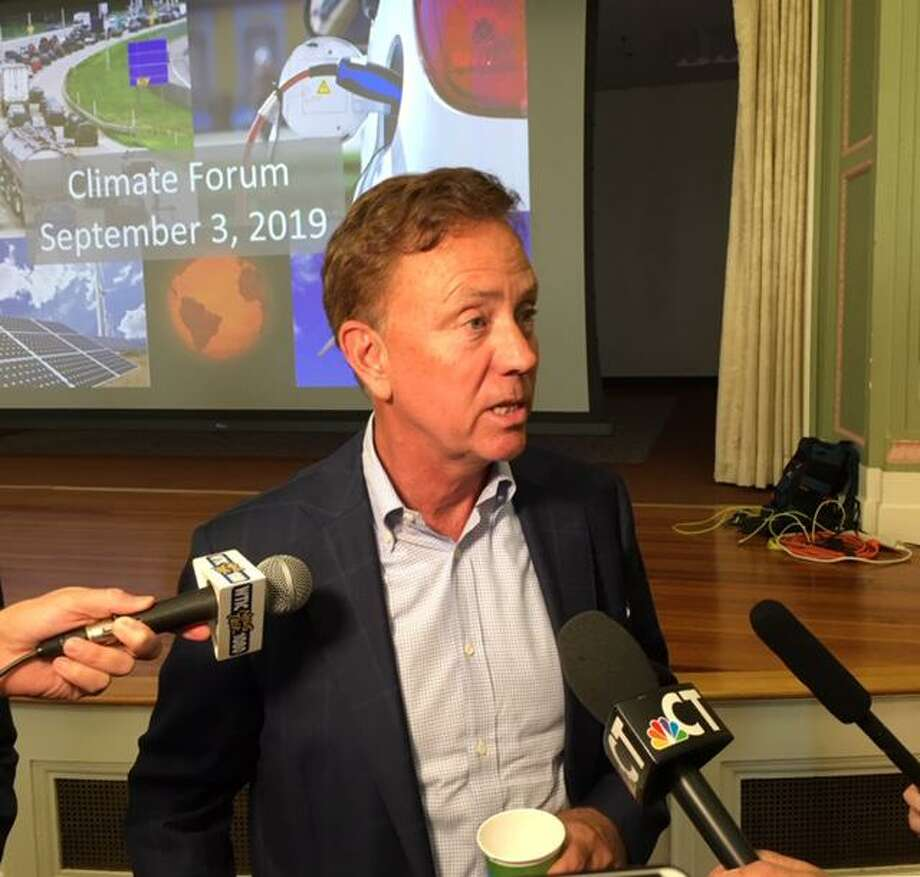 Gov. Ned Lamont discusses climate change at a summit Sept. 3 in Hartford. Photo: Mark Pazniokas / Connecticut Mirror