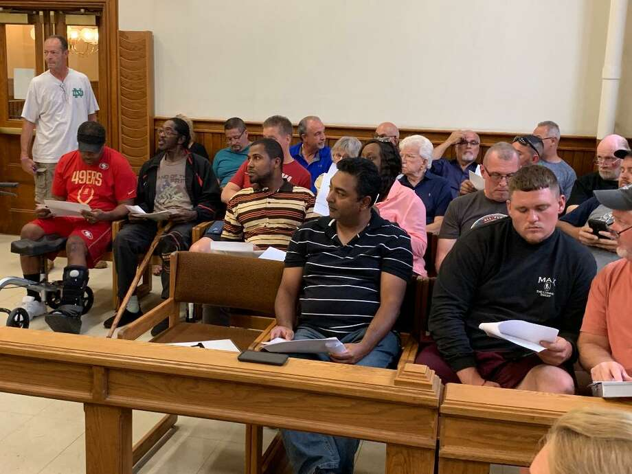 Thirty-three people registered to participate in the aution of 19 pieces of property on which taxes are owed. The auction took place in the Aldermanic chambers of City Hall on Sept. 5, 2019. Photo: / Michael P. Mayko