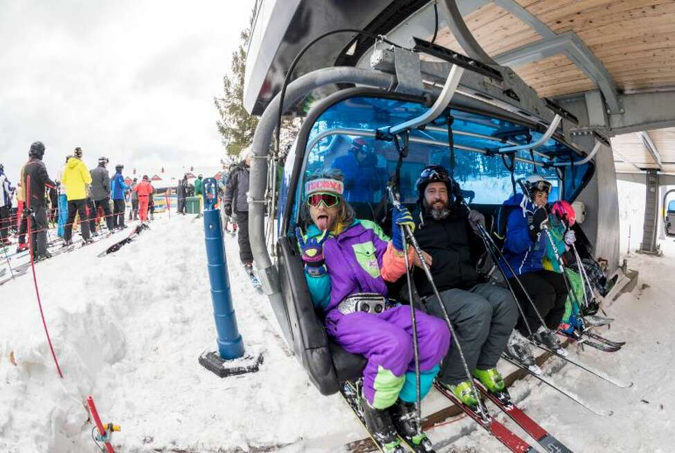 This photo taken Nov. 17, 2018, in West Dover, Vt., shows skiers getting onto a chair lift at the Mount Snow ski resort. Early season snow and cold temperatures are helping New England ski resorts get the 2018-2019 season off to a blizzard of a start.