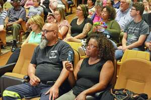 About 200 attended the Middletown AAUW and League of Women Voters of Connecticut Democratic mayoral forum Thursday at Keigwin Middle School, filling the auditorium seats.