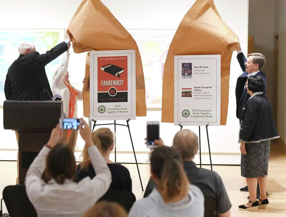 From left, Former Selectman John Toner, Friends of the Greenwich Library Chair Hilary Martin Lea, Board of Trustees President Rob Marks, and Library Director Barbara Ormerod-Glynn reveal the picks for the Greenwich Reads Together last summer. There are now four finalists for the 2020 selection and residents can vote on it until May 29. Photo: Tyler Sizemore / Hearst Connecticut Media / Greenwich Time