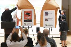 From left, Former Selectman John Toner, Friends of the Greenwich Library Chair Hilary Martin Lea, Board of Trustees President Rob Marks, and Library Director Barbara Ormerod-Glynn reveal the picks for the Greenwich Reads Together last summer. There are now four finalists for the 2020 selection and residents can vote on it until May 29.