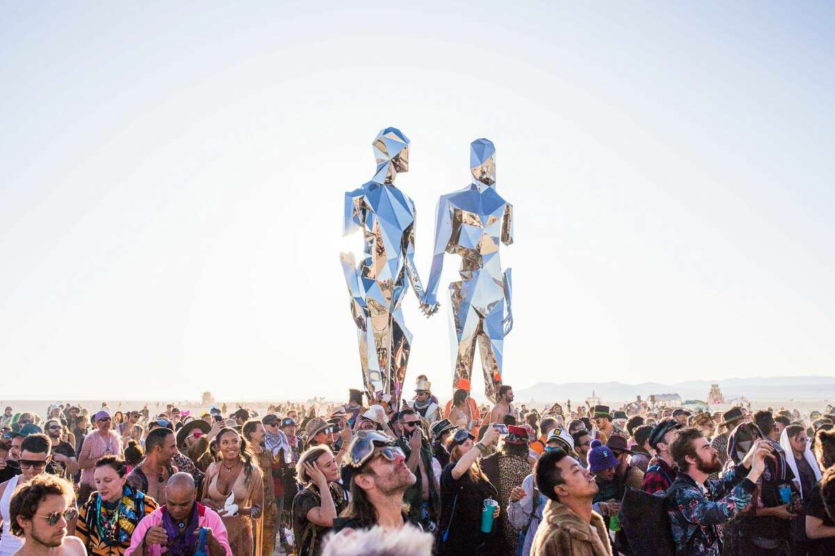 FILE - One of the artworks at Burning Man 2019, the largest outdoor arts festival in North America, in the Black Rock desert of Gerlach, Nevada. Burning Man organizers haven't officially cancelled or moved the date of the annual event, but announced Monday that ticket sales have been postponed.