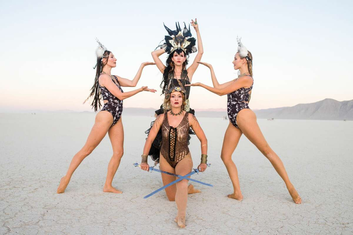 """Dreyma dancers Tracy Windisch, Aradia Julia Sunseri, Marlowe Bassett, and Cassandra Davis (clockwise from left) at Burning Man 2019, the largest outdoor arts festival in North America, in the Black Rock desert of Gerlach, Nevada. Windisch on performing at Burning Man, """"It's freeing because since no one is being paid to do it, everyone gives it their all, I don't have to hold back because the event wasn't willing to pay for my full expression."""""""