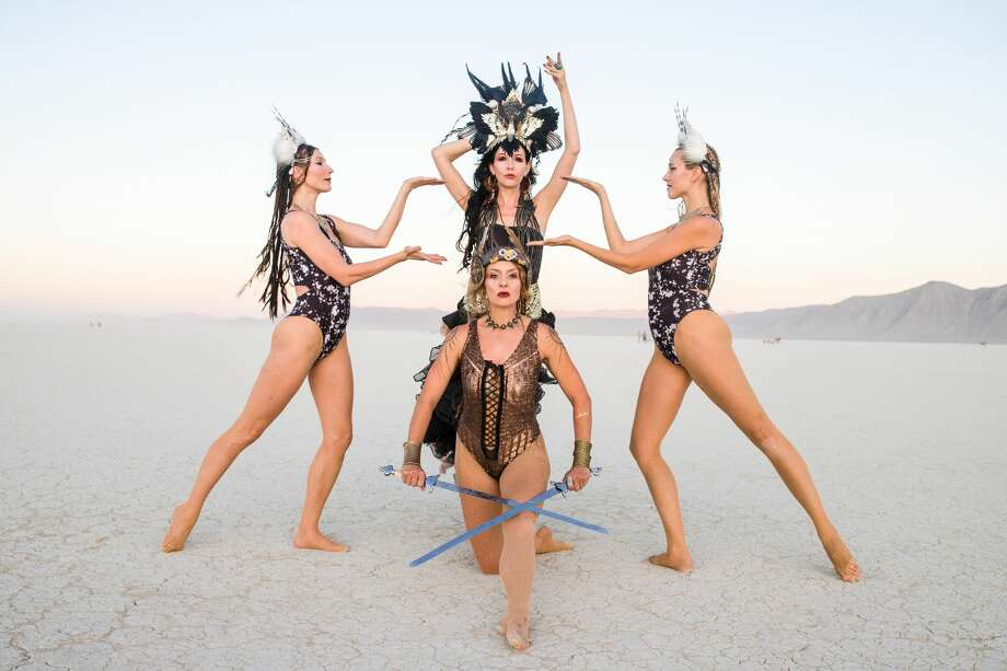 "Dreyma dancers Tracy Windisch, Aradia Julia Sunseri, Marlowe Bassett, and Cassandra Davis (clockwise from left) at Burning Man 2019, the largest outdoor arts festival in North America, in the Black Rock desert of Gerlach, Nevada. Windisch on performing at Burning Man, ""It's freeing because since no one is being paid to do it, everyone gives it their all, I don't have to hold back because the event wasn't willing to pay for my full expression."" Photo: Jane Hu"