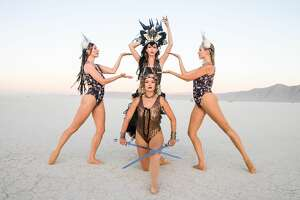Dancers Marlowe Bassett and Tracy Windisch perform at  Burning Man 2019, the largest outdoor arts festival in North America, in the Black Rock desert of Gerlach, Nevada.