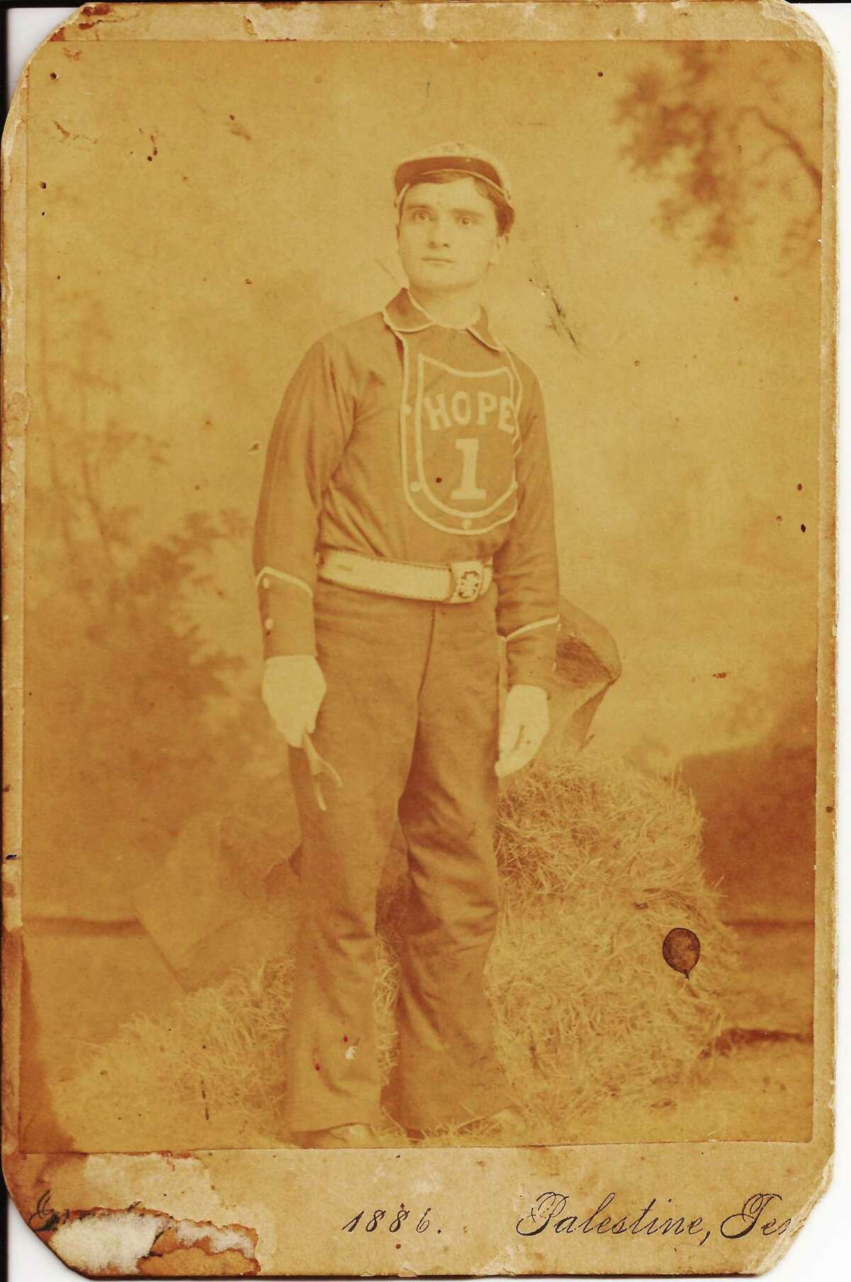 Giovanni Bernardoni, shown in 1886 in a volunteer fireman's uniform in Palestine, Texas, emigrated from Bientina, Italy to the U.S. through New Orleans. He and his wife, Lucile Cariola Bernardoni, had two children in New Orleans but moved to Galveston, where he opened a tavern on Broadway shortly before the 1900 storm. He perished in the storm after placing his wife and two children on higher ground and going back to help neighbors. His great grandson, John M. Bernardoni, leads the Lost Coppini Statue Project to recreate a memorial to the storm victims that was designed by Italian sculptor Pompeo Coppini in 1904 but never realized in bronze.