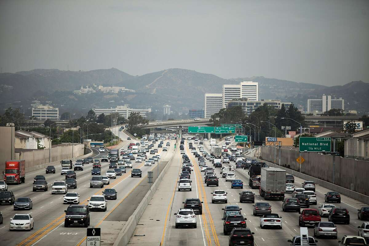 FILE-- Traffic on I-405 in Los Angeles, July 25, 2019. The Justice Department has opened an antitrust inquiry into the four major automakers that struck a deal with California this year to reduce automobile emissions, according to people familiar with the matter, escalating a standoff between President Donald Trump, California and the auto industry over one of his most significant rollbacks of climate regulations. (Jenna Schoenefeld/The New York Times)