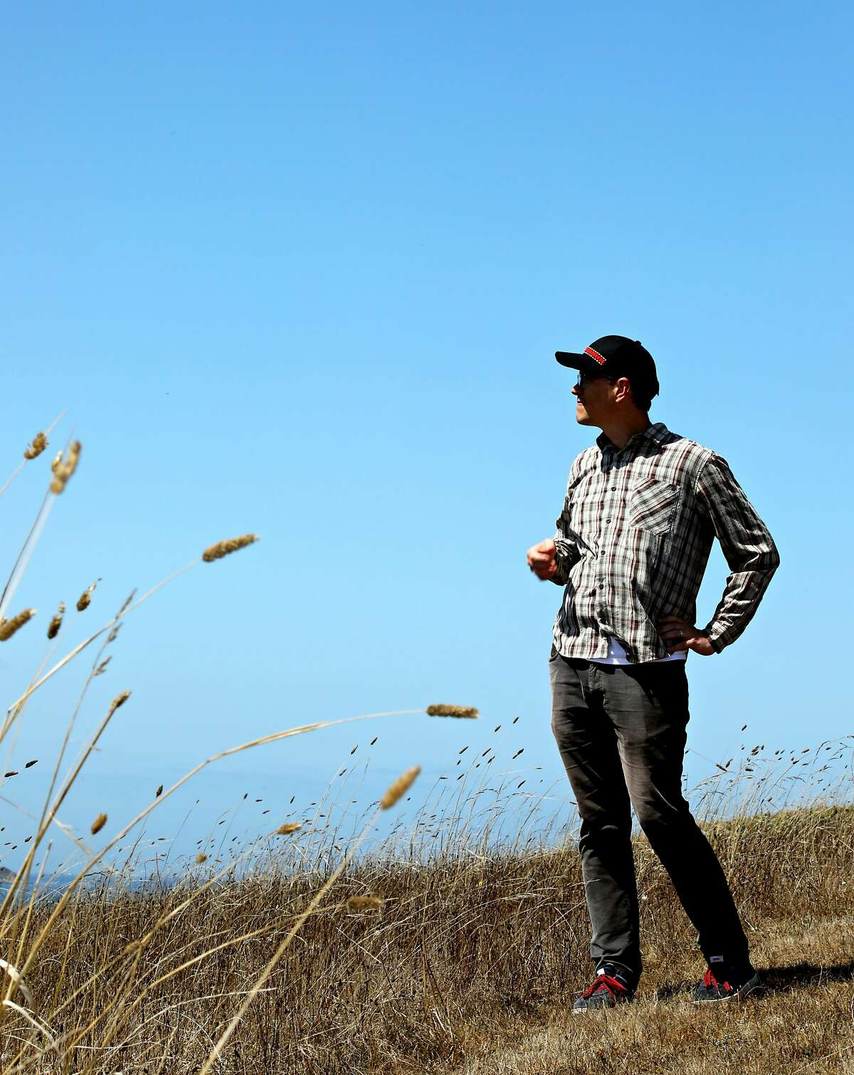 Tsim Schneider, 40, assistant professor, department of anthropology, University of California, Santa Cruz, poses for a portrait on Tom's Point in Tomales Bay, Calif., on Thursday, August 29, 2019. The Coast Miwok and Southern Pomo Indians of Marin County were not exterminated by Spanish and American colonists. They not only survived colonization, but they preserved and passed on their culture and traditions for many decades, often living independently in their old stomping grounds while an often hostile culture grew around them, according to a study by Schneider and Lee Panich (not pictured), of Santa Clara University. They found from artifacts recovered from Tom's Point, in Tomales Bay, and other sites in Marin County that the native people persisted despite the missions and discriminatory policies by the federal government. In many ways, their legacy lives on in society today, according to Schneider, a member of the Federated Indians of Graton Rancheria, the federally recognized tribe of Coast Miwok and Southern Pomo people.