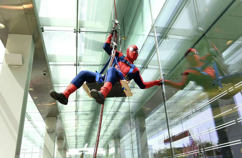 Manuel Martinez of Tristate Facade Services rappels down the side of Yale New Haven Hospital near the Emergency Room entrance dressed as Spider-Man Sept.  5, 2019. Martinez, along with Rigoberto Alvarado as Superman and Evan Bennett as Captain America, earlier rappelled down the side of Yale New Haven Children's Hospital. The three normally clean windows and perform exterior maintenance on tall buildings. Photo: Arnold Gold / Hearst Connecticut Media / New Haven Register