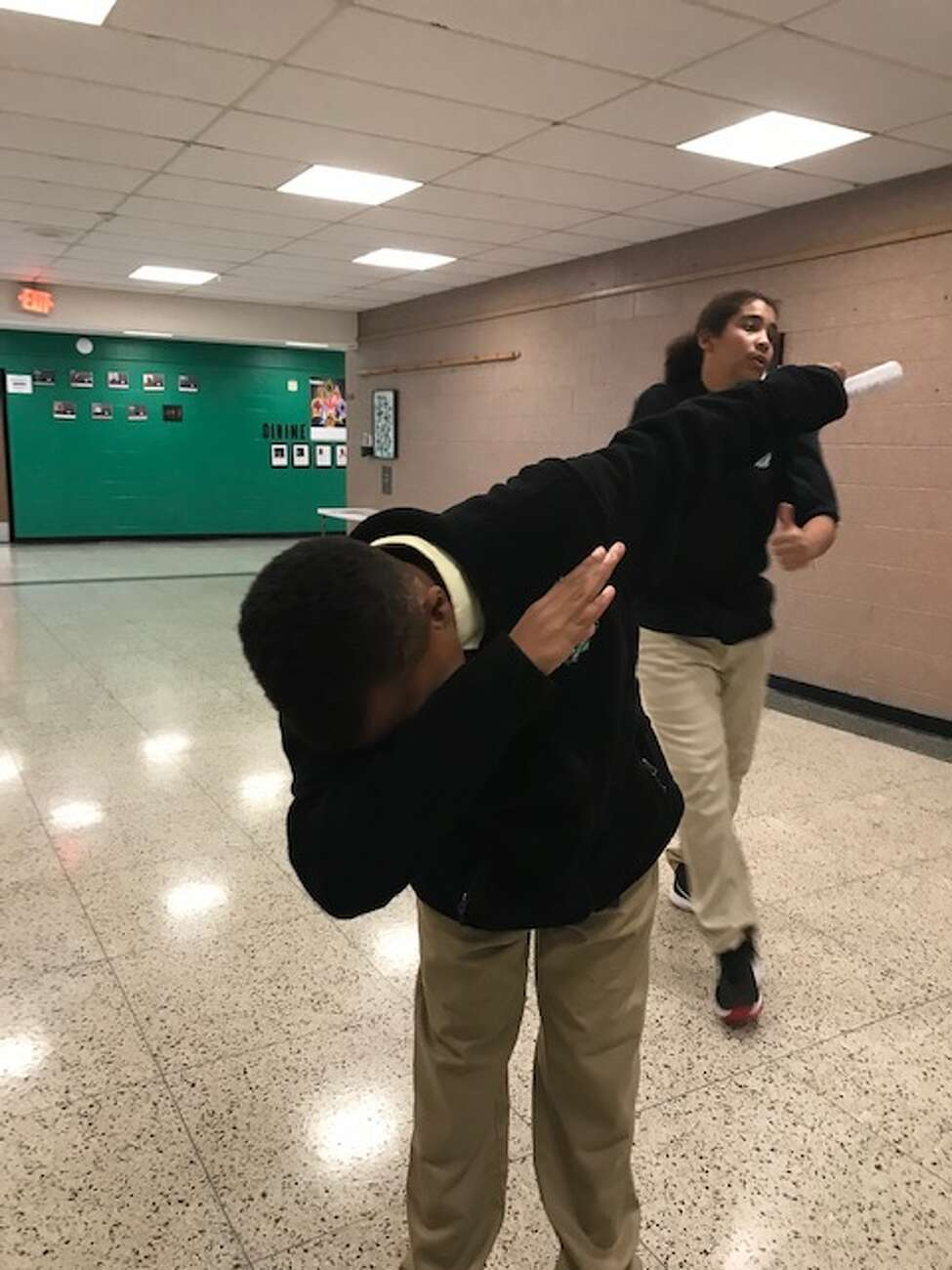 Aidan Park, a sixth grader at Green Tech Charter High School, demonstrates how he taught a homeless man to dab during the school's annual