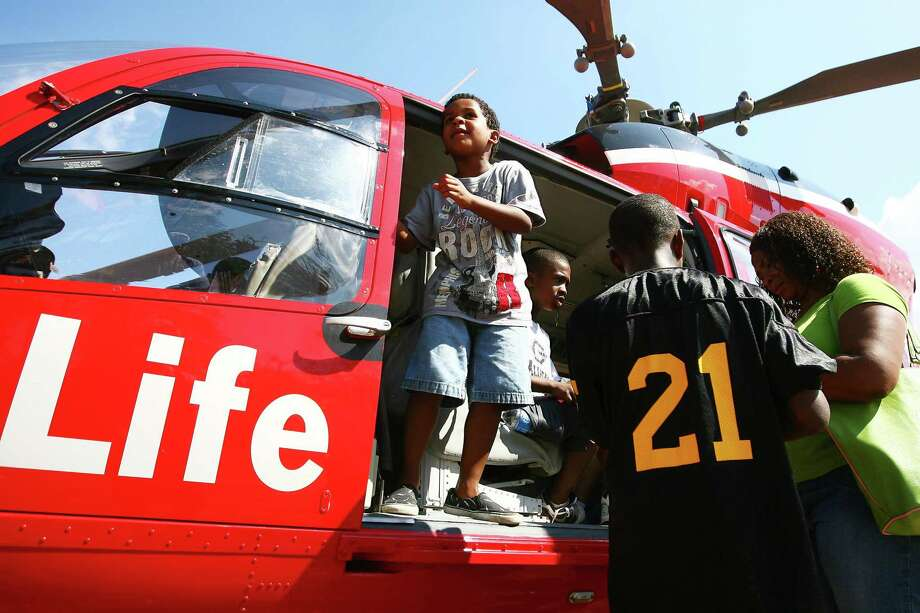 Children take a tour of Memorial Herman's Life Flight helicopter during a previous Conroe Noon Kiwanis Club's Kids' Day at the Park at Carl Barton, Jr. Park. This year's event is set for this Saturday. Photo: Staff Photo By Karl Anderson / Staff photo by Karl Anderson