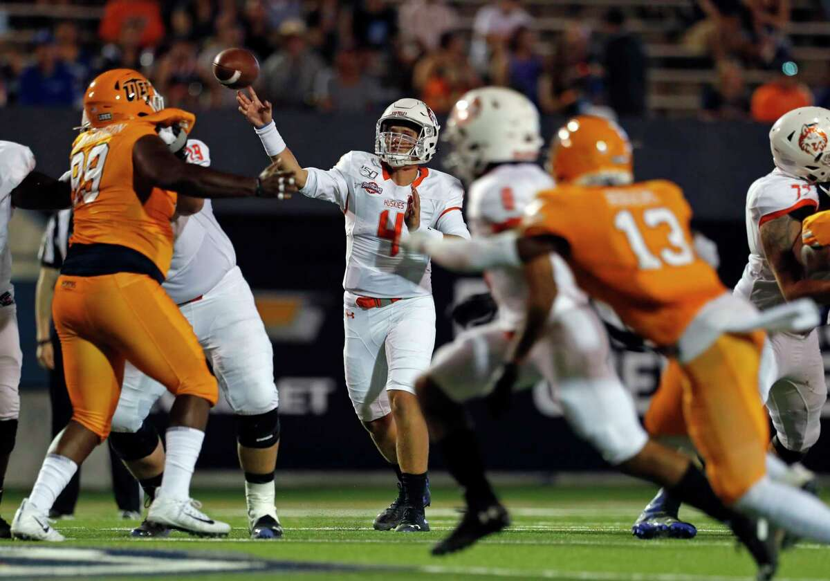 Houston Baptist quarterback Bailey Zappe (4) throws during the second half of an NCAA football game against UTEP on Saturday, Aug. 31, 2019 in El Paso, Texas. (AP Photo/Andres Leighton)