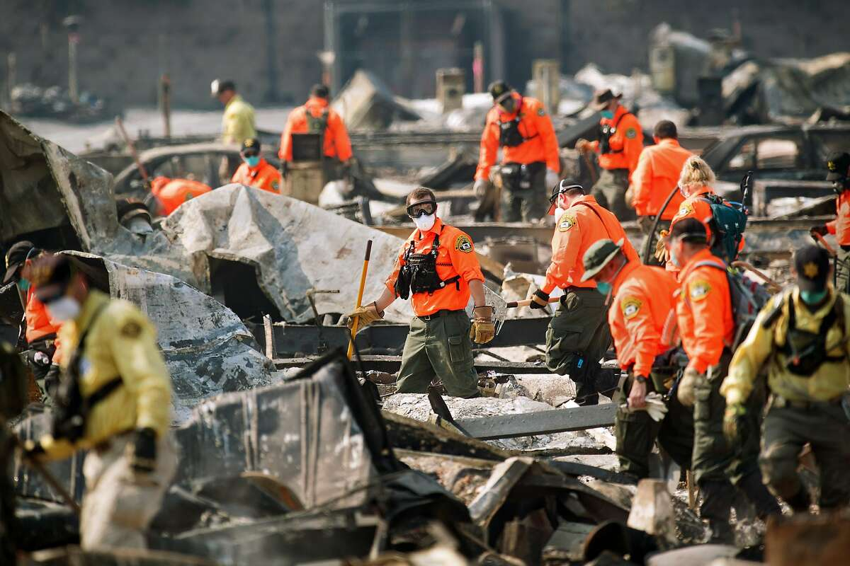 Search and rescue workers comb through the Journey's End Mobile Home Park in Santa Rosa, Calif. The confirmed death toll from the North Bay fires is 44, including several residents of Journey's End. (Noah Berger, San Francisco Chronicle - Oct. 13, 2017)