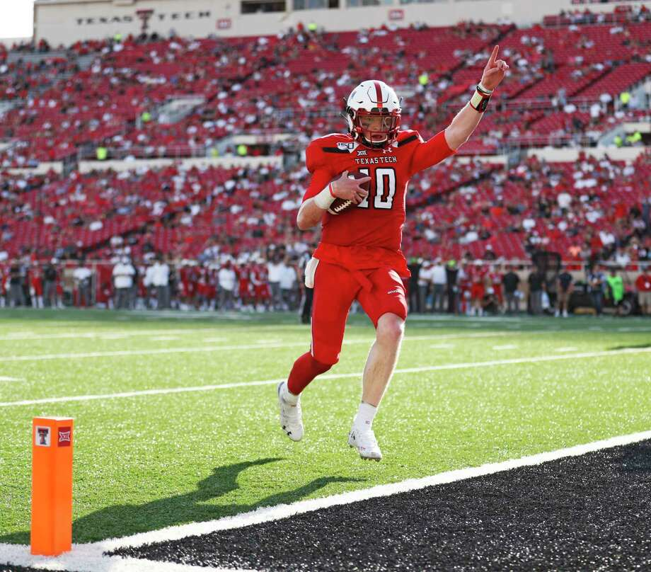 PHOTOS: Texas college football stadiums that serve alcohol  Texas Tech's Alan Bowman (10) scores a touchdown against Montana State during the second half of an NCAA college football game Saturday, Aug. 31, 2019, in Lubbock, Texas. (Brad Tollefson/Lubbock Avalanche-Journal via AP)  >>>See which college football stadiums in the state sell alcohol ...  Photo: Brad Tollefson, Associated Press / Lubbock Avalanche-Journal