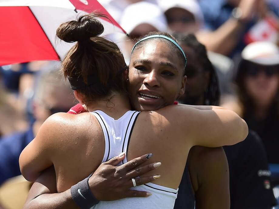 Canada's Bianca Andreescu, left, consoles Serena Williams, of the United States, after Williams had to retire from the final of the Rogers Cup tennis tournament in Toronto, Sunday, Aug. 11, 2019. (Frank Gunn/The Canadian Press via AP) Photo: Frank Gunn / Associated Press