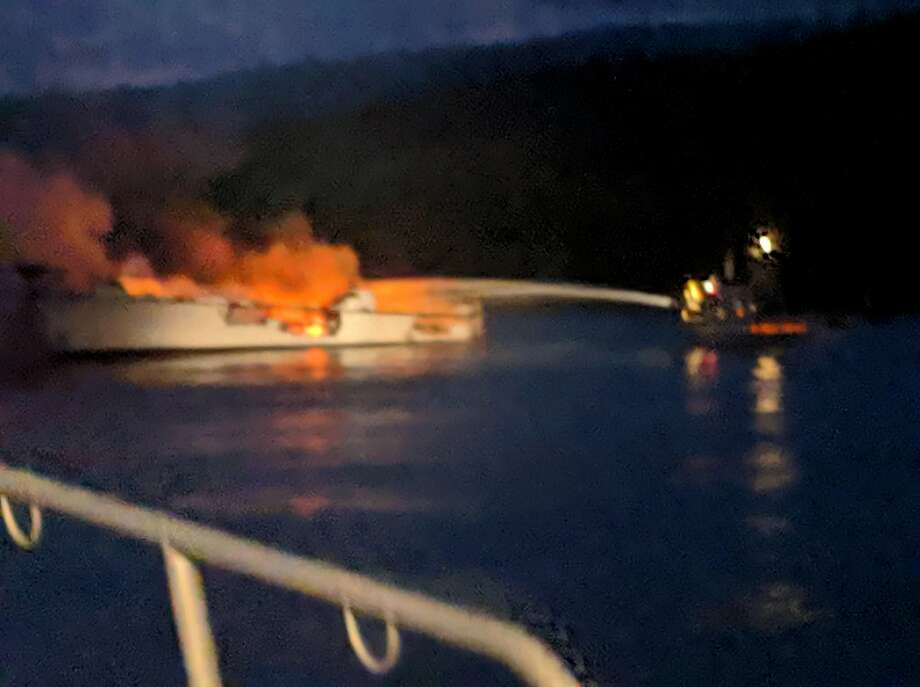 Firefighters work to extinguish flames engulfing the Conception, a scuba diving boat where 34 people died, early on Labor Day. Photo: Santa Barbara County Fire Department