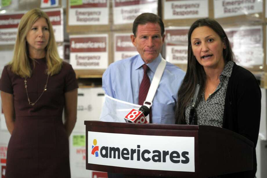 Kate Dischino, Vice President of Emergency Programs speaks during a press conference held in the distribution center at Americares, in Stamford, Conn. Sept. 6, 2019. Pallets of emergency relief supplies have been prepared for shipment to the Bahamas and Florida to help those affected by Hurricane Dorian. Photo: Ned Gerard / Hearst Connecticut Media / Connecticut Post