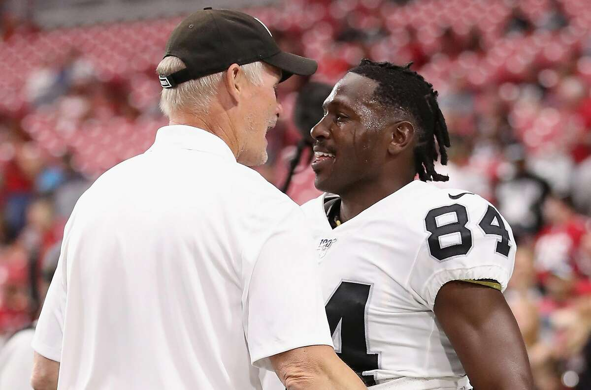 GLENDALE, ARIZONA - AUGUST 15: Wide receiver Antonio Brown #84 of the Oakland Raiders talks with general manager Mike Mayock before the NFL preseason game against the Arizona Cardinals at State Farm Stadium on August 15, 2019 in Glendale, Arizona. ~~