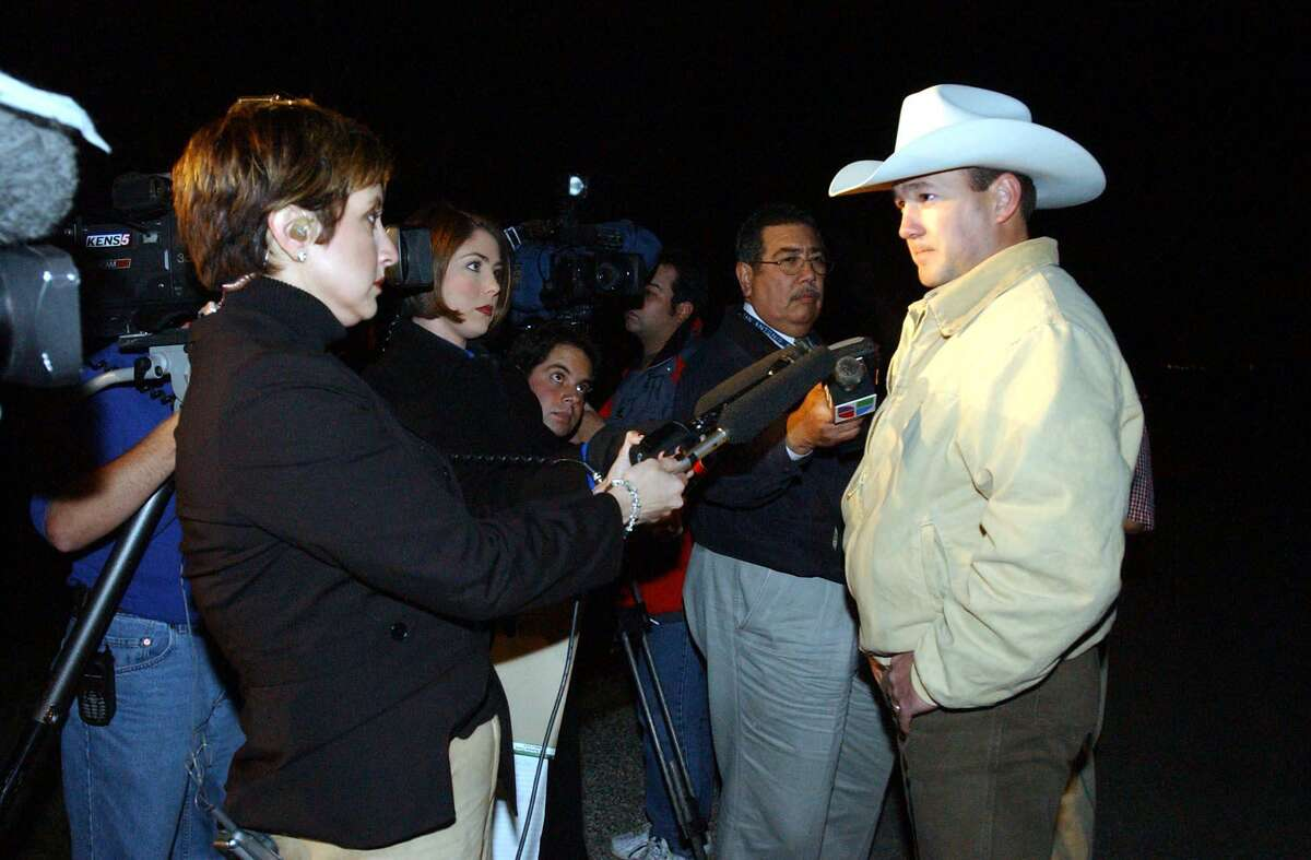 NEWS-- Texas Rangers Sgt. Skylor Hearn speaks with the media near the enterance of an abandoned farmhouse on South W.W. White road where charred human remains were found Tuesday Jan. 14, 2003. Texas Rangers searched the area based on a tip from the Susan McFarland case. ( Joshua Trujillo / Staff )