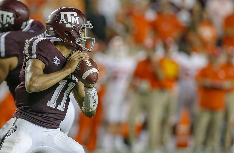 PHOTOS: College football betting odds for Week 2  COLLEGE STATION, TX - SEPTEMBER 08: Kellen Mond #11 of the Texas A&M Aggies looks for a receiver against the Clemson Tigers at Kyle Field on September 8, 2018 in College Station, Texas. (Photo by Bob Levey/Getty Images) >>>See the odds for this week's matchups ...  Photo: Bob Levey/Getty Images