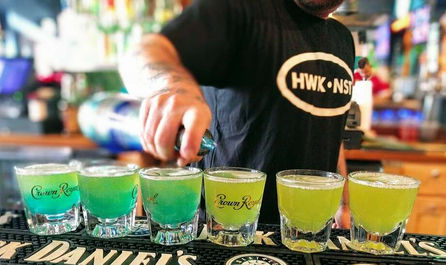 The Hawks Nest: The name says it all, but as an added bonus, their entire menu and cocktail list is inspired by the Seahawks. From the Hawkchos with blue corn tortilla chips and lime crema, to the Hawks Nest Punch showered with coconut rum, melon liqueur, and blue curacao, it's a place made by a fan, for the fans. Photo: Courtesy Jenna S/Yelp