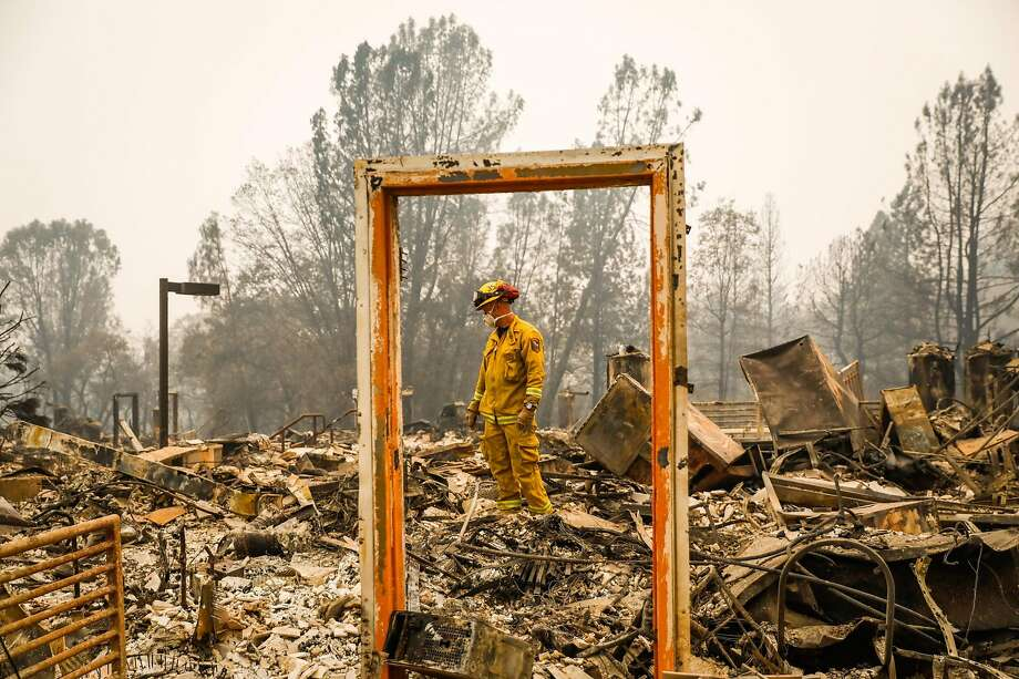 Amid the wreckage of the Paradise Community Village Apartments, firefighter Mike Rea searches for remains. Photo: Gabrielle Lurie / San Francisco Chronicle