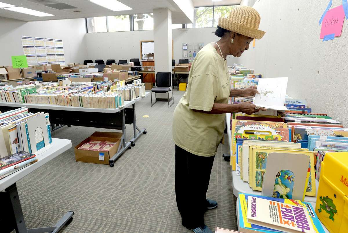 Dora Nisby selects books to be purchased for the Beaumont Association of Retired Teachers, who will donate them to K - third grade children in BISD schools in need of books at home. Nisby says the purchasing organization comprised of retired BISD administrators put no limit on how many books can be selected, which, at a price of 10 cents apiece, should put books in homes for many children in need. Saturday's public book sale begins at 8 a.m. and runs through 4 p.m. at the main branch on Pearl Street. Cash and check payments are accepted. Photo taken Friday, September 6, 2019 Kim Brent/The Enterprise