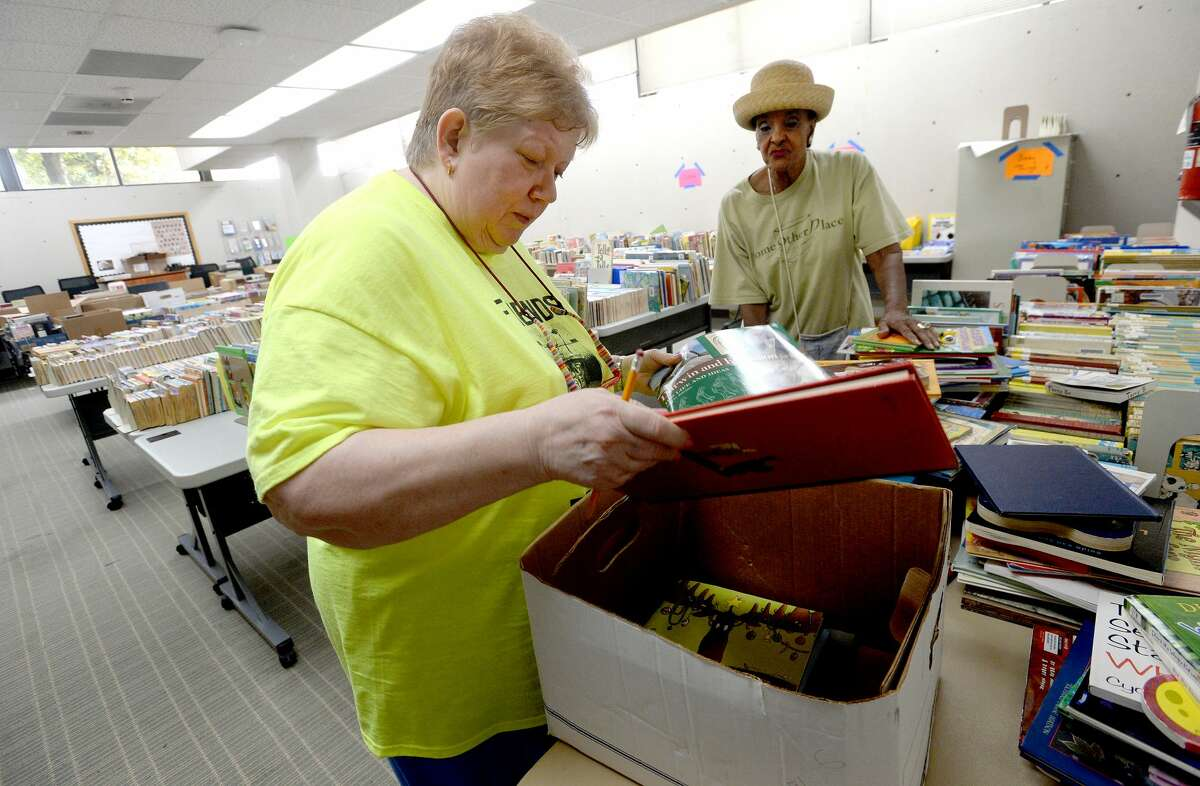 Susan Knabeschuh (left) and Dora Nisby pull and count books to be purchased for the Beaumont Association of Retired Teachers, who will donate them to K - third grade children in BISD schools in need of books at home. Nisby says the purchasing organization comprised of retired BISD administrators put no limit on how many books can be selected, which, at a price of 10 cents apiece, should put books in homes for many children in need. Saturday's public book sale begins at 8 a.m. and runs through 4 p.m. at the main branch on Pearl Street. Cash and check payments are accepted. Photo taken Friday, September 6, 2019 Kim Brent/The Enterprise