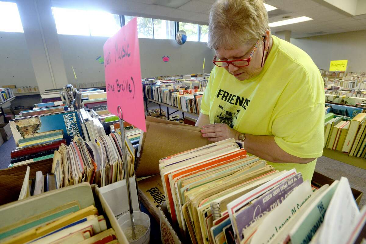 Friends of the Beaumont Publuc Library System member Susan Knabeschuh makes sure things are in order in the main room as they prepare for a fall book sale this weekend. Saturday's public book sale begins at 8 a.m. and runs through 4 p.m. at the main branch on Pearl Street. Cash and check payments are accepted. A Friday night pre-sale from 5 - 8 p.m. is open to friends members and others wishing to join that night. Photo taken Friday, September 6, 2019 Kim Brent/The Enterprise