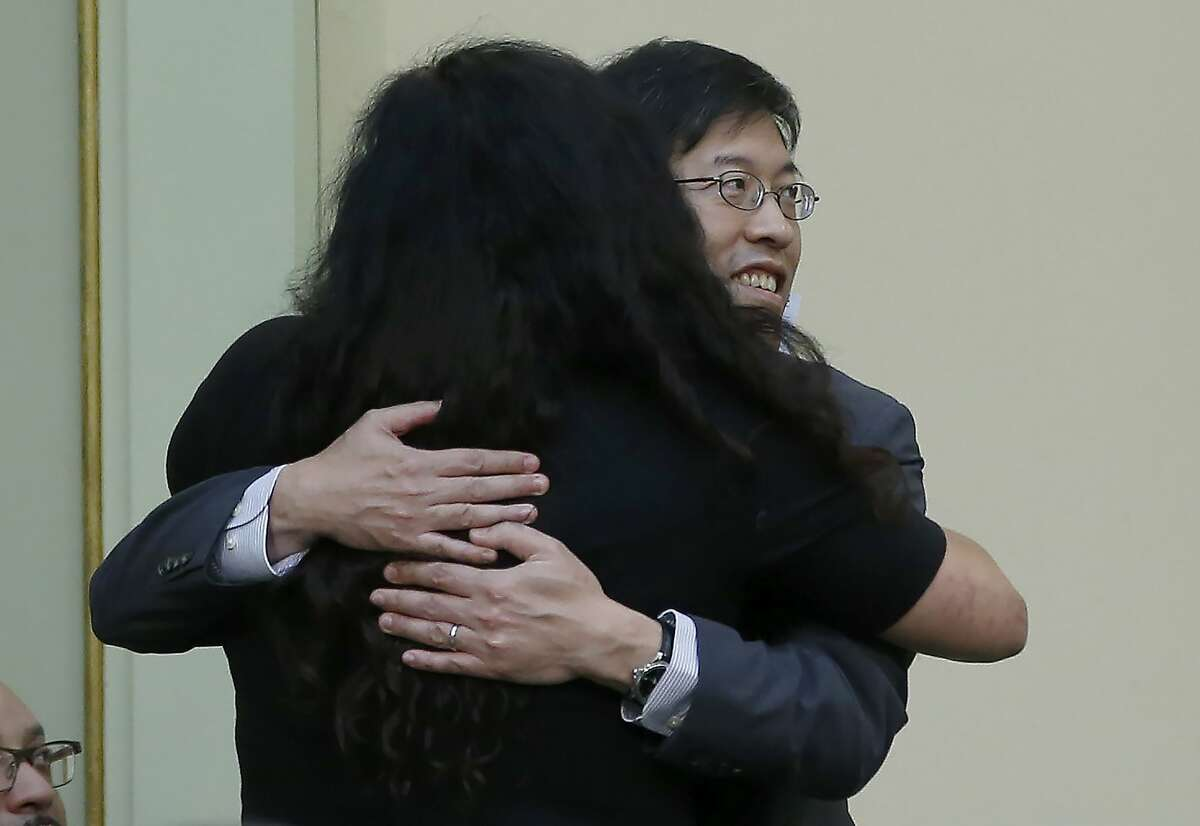 State Sen. Richard Pan, D-Sacramento, is hugged by Assemblywoman Lorena Gonzalez, D-San Diego, to tighten the rules on giving exemptions for vaccinations was approved by the Assembly in Sacramento, Calif., Tuesday, Sept. 3, 2019. The bill SB276, would give state public health officials oversight of doctors who give more than five medical exemptions annually and schools with vaccination rates less than 95%. It still needs a final approval in the state Senate. (AP Photo/Rich Pedroncelli)