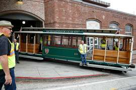 Cable car #19 leaves the cable car barn with cable car staff to run some tests on Friday, August 30, 2019 in San Francisco, CA.