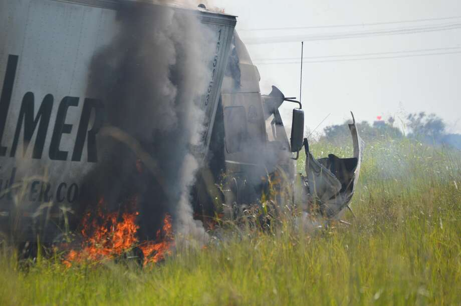 Emergency crews respond to an 18-wheeler that caught fire on the westbpound I-10 access road just past Major Drive Friday afternoon. The stretch of road was shut down between Major Drive and Smith Road while the scene was cleared. Photo taken Friday, September 6, 2019 Eric Williams/Special to The Enterprise Photo: Eric Williams/The Enterprise