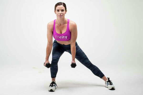 Lateral Lunge to Dumbbell Curl. Step 1