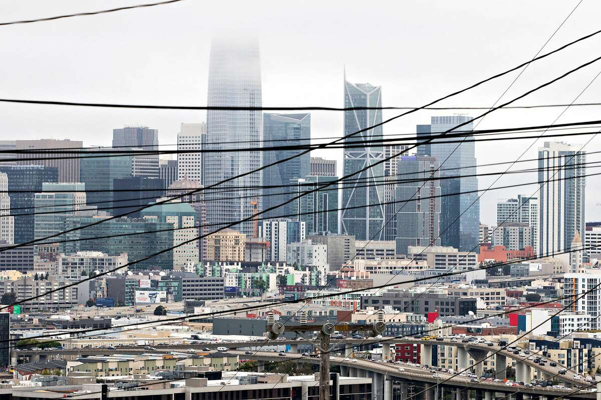 PG&E power lines cross over the San Francisco skyline seen from 20th and Carolina streets in the Potrero Hill neighborhood of San Francisco, Calif. Friday, July 26, 2019.