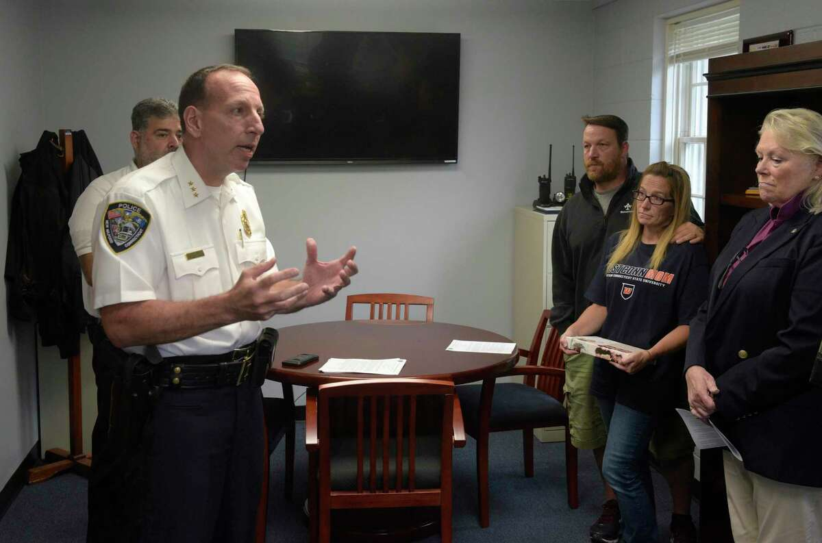 New Milford Mayor Pete Bass, left, and Police Chief Spencer Cerrito held a press conference to announce their plans to combat the towns opioid crisis. Friday afternoon, September 6, 2019, in New Milford, Conn. Tracey Morrissey and Tony Morrissey parents of Brian Cody Waldron attended the event.