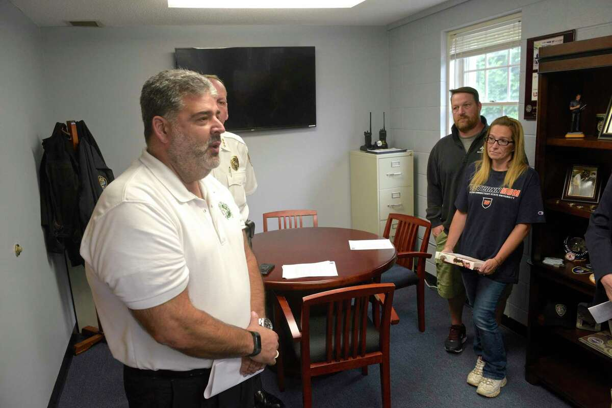 New Milford Mayor Pete Bass, left, and Police Chief Spencer Cerruto held a press conference to announce their plans to combat the towns opioid crisis. Friday afternoon, September 6, 2019, in New Milford, Conn. Tracey Morrissey and Tony Morrissey parents of Brian Cody Waldron attended the event.