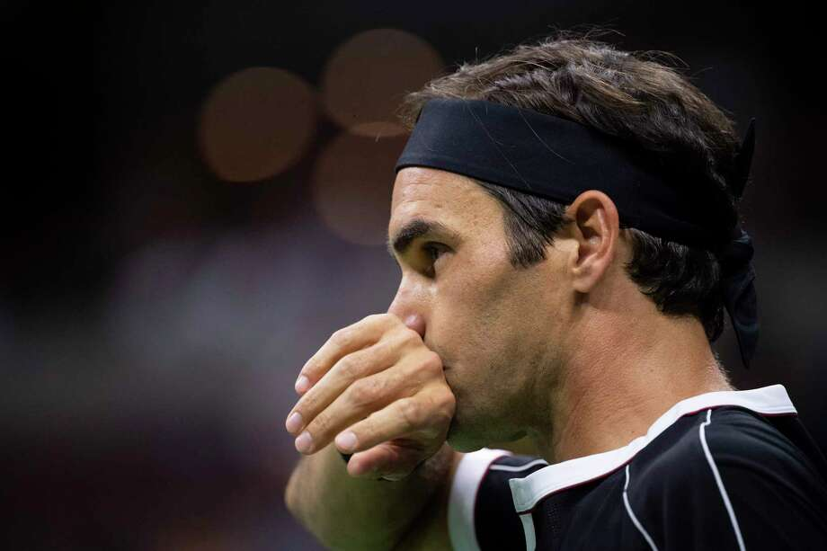 "Roger Federer of Switzerland reacts after a point during his match with Grigor Dimitrov of Bulgaria at the U.S. Open in New York. A reader says Federer and Gael Monfils were both visibly exhausted in a recent match, and suggests maybe they should be playing in a ""senior league"" for players over 30. Photo: BEN SOLOMON /NYT / NYTNS"