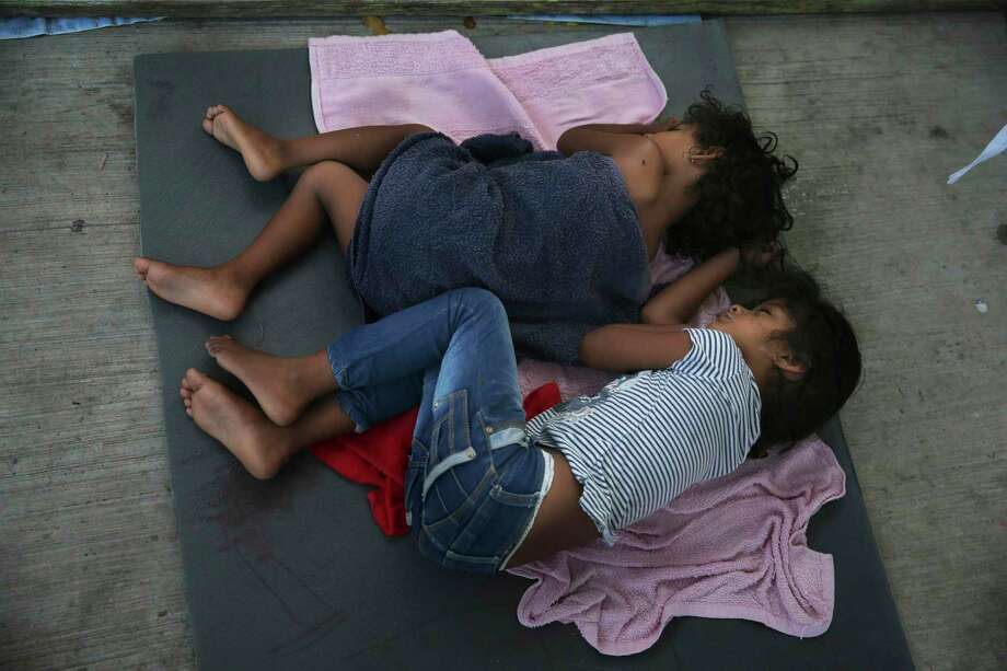 Migrant children sleep on a mattress on the floor of a shelter this summer in Nuevo Laredo, Mexico. The Trump administration has placed a cruel focus on migrant children. Photo: Marco Ugarte /Associated Press / Copyright 2019 The Associated Press. All rights reserved.