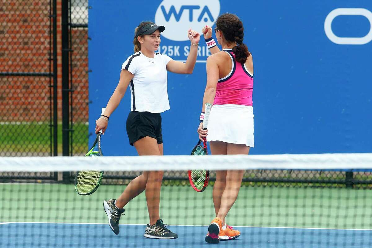 Usue Maitane Arconada, left, and Jamie Loeb celebrate during their match against Naomi Broady and Fanny Stollar at the Yale University Tennis Center during the Oracle Challenger Series on Friday in New Haven, Conn.