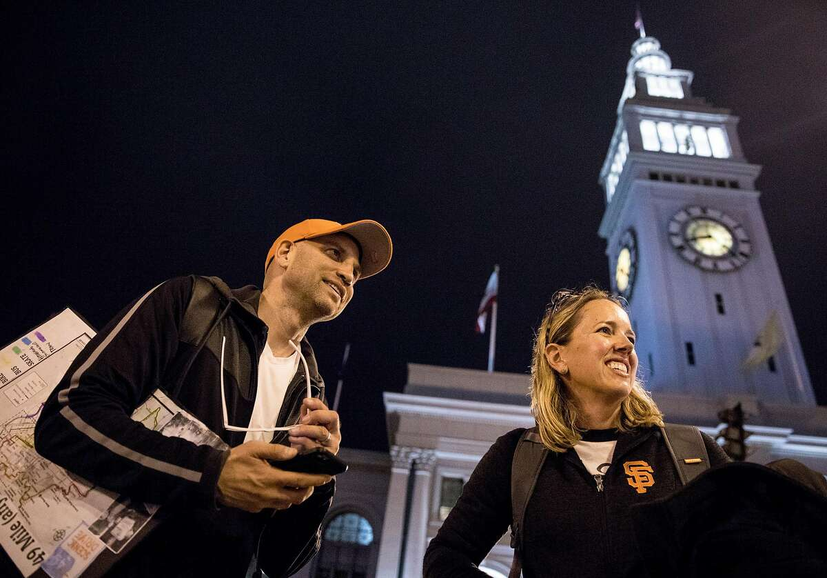 San Francisco Chronicle reporters Heather Knight and Peter Hartlaub wait for an F-Car underneath the Ferry Building in San Francisco, Calif. Wednesday, September 4, 2019 as they attempt to traverse San Francisco�s 49-mile Scenic Drive without using a car.