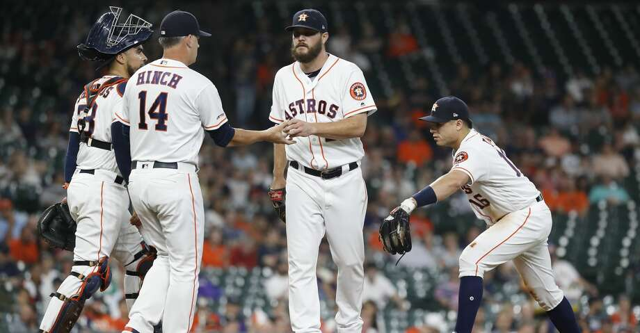 PHOTOS: Astros 11, Mariners 9 (13 innings) Houston Astros starting pitcher Wade Miley (20) is pulled by  manager AJ Hinch (14) after just 31 pitches during the first inning of an MLB game at Minute Maid Park, Thursday, September 5, 2019, in Houston. Browse through the photos to see action from the Astros' win over the Mariners on Thursday. Photo: Karen Warren/Houston Chronicle