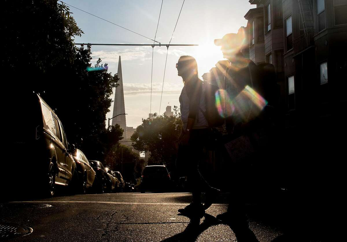 San Francisco Chronicle reporters Heather Knight and Peter Hartlaub walk north on Mason Street in San Francisco, Calif. Wednesday, September 4, 2019 as they attempt to traverse San Francisco�s 49-mile Scenic Drive without using a car.